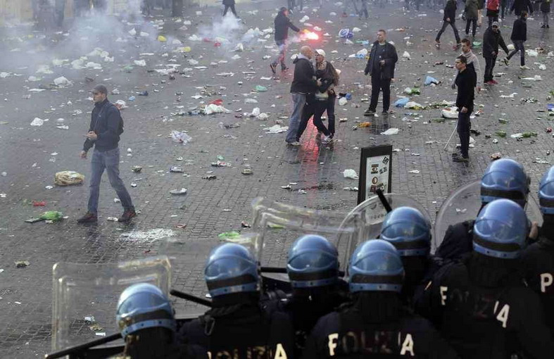 Feyenoord fans stand at the Spanish Steps during clashes with police prior to the start of the Europa League soccer match between AS Roma and Feyenoord in Rome