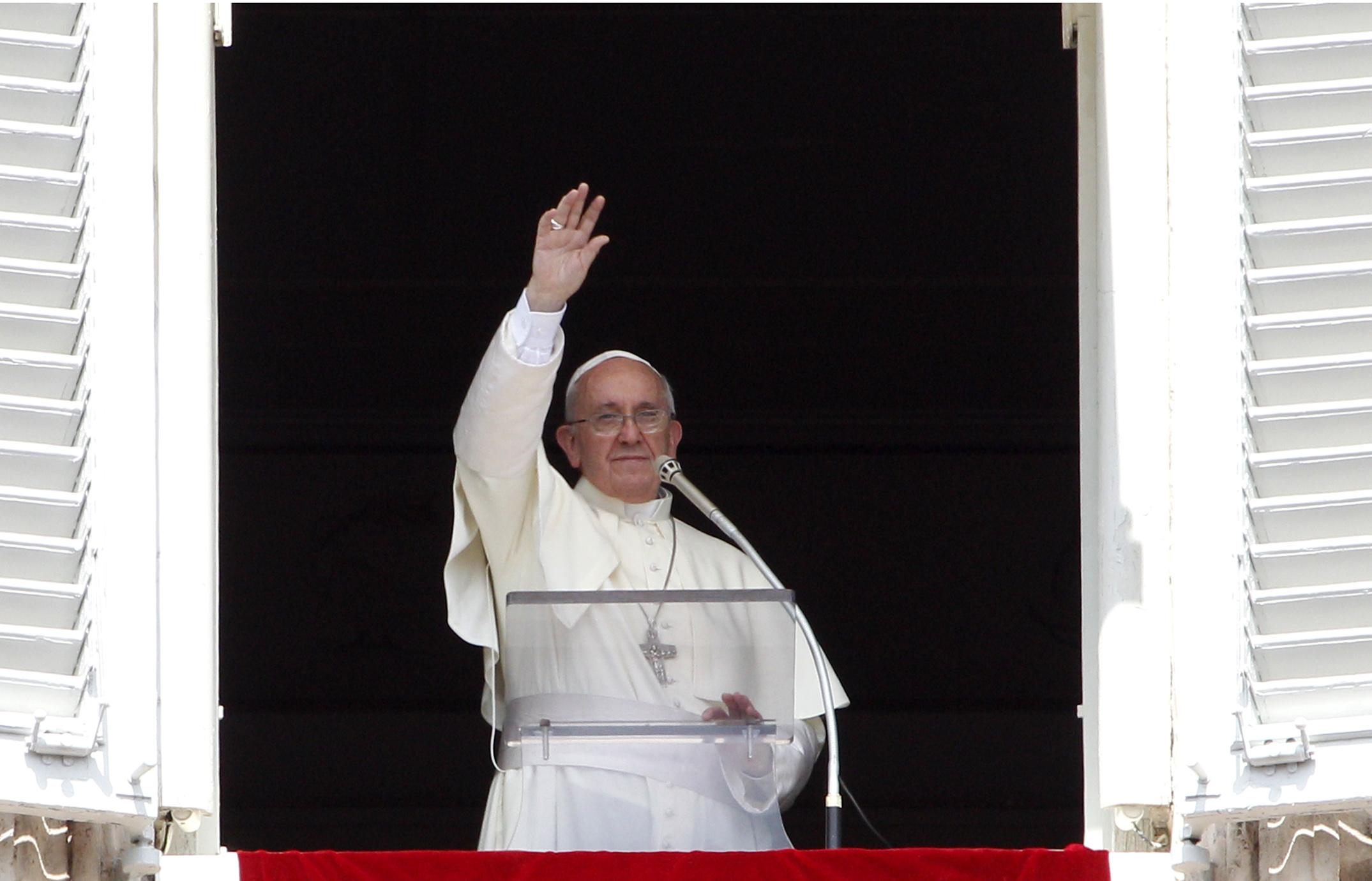 "Pope Francis waves to faithful after reciting the Angelus prayer from his studio window overlooking St.Peter's Square at the Vatican, Sunday, Sept. 1, 2013. Francis is asking people to join him next weekend in a day of fasting for peace in Syria. The pontiff invited people of all faiths to join him Saturday evening in St. Peter's Square to invoke the ""gift"" of peace for Syria, the rest of the Middle East and worldwide where there is conflict. (AP Photo/Riccardo De Luca)"