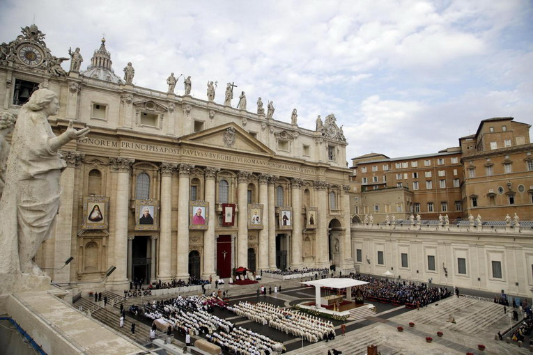 From left, the tapestries of Eufrasia Eluvathingal, Amato Ronconi, Antonio Farina, Kuriakose Elias Chavara, Nicola Saggio da Longobardi and Amato Ronconi are displayed on St. Peter's Basilica during their Canonization mass celebrated by Pope Francis in St. Peter's Square, at the Vatican, Sunday, Nov. 23, 2014. (AP Photo/Gregorio Borgia)