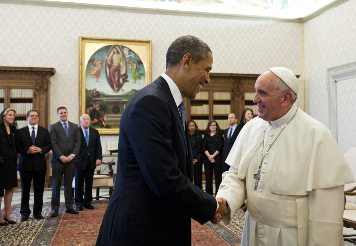 Pope Francis (R) and US President Barack Obama shake hands during a private audience on March 27, 2014 at the Vatican. The meeting at the Vatican comes as a welcome rest-stop for Obama during a six-day European tour dominated by the crisis over Crimea, and the US leader will doubtless be hoping some of the pope's overwhelming popularity will rub off on him.    AFP PHOTO / SAUL LOEB
