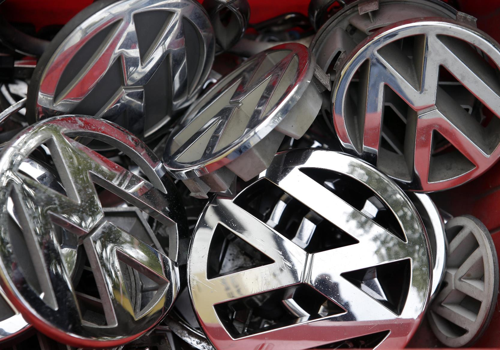 Company logos of the German car manufacturer Volkswagen sit in a box at a scrap yard in Berlin, Germany, Wednesday, Sept. 23, 2015. (ANSA/AP Photo/Michael Sohn)