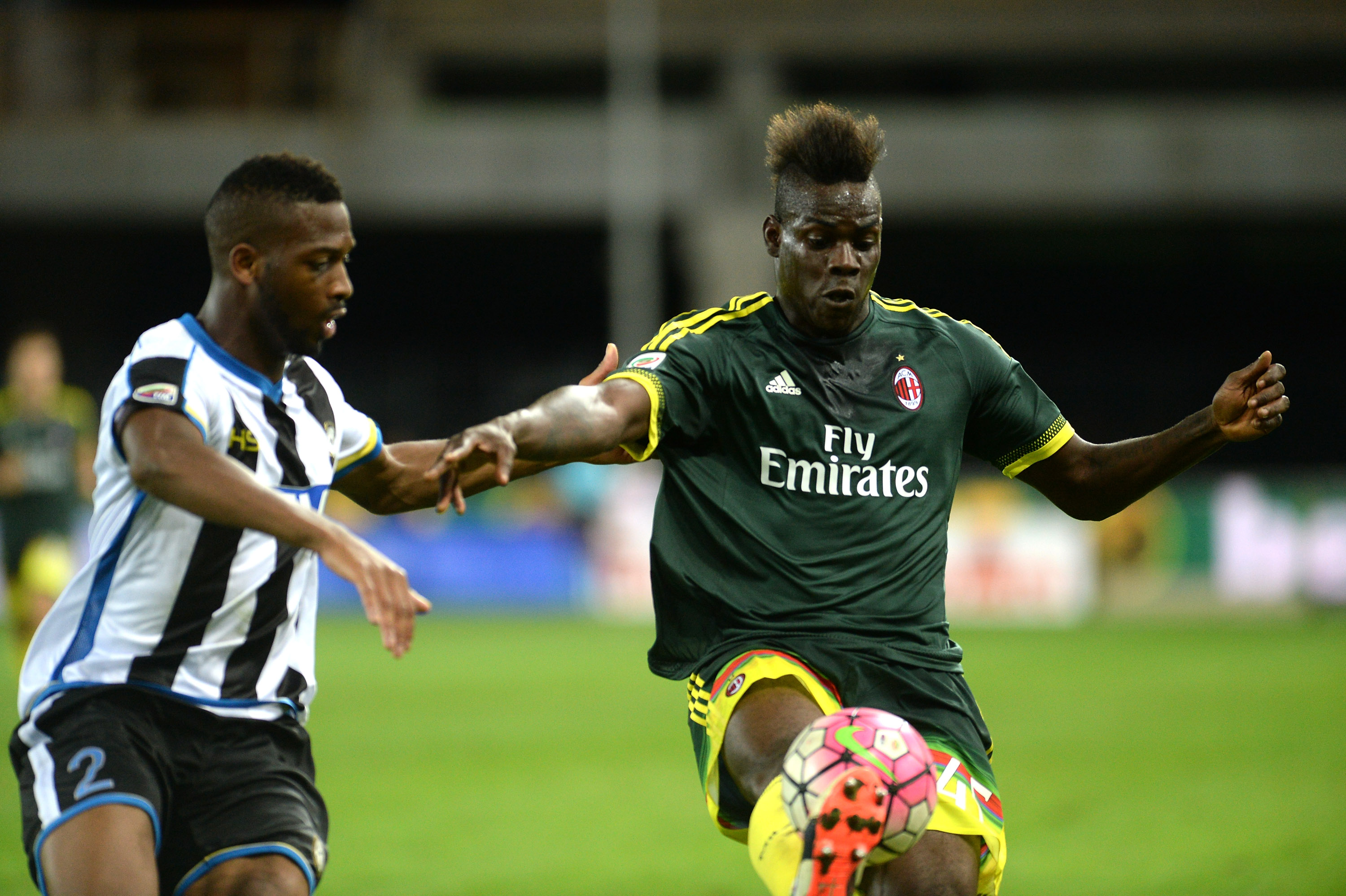 UDINE, ITALY - SEPTEMBER 22:  Molla Wague (L) of Udinese Calcio competes  with Mario Balotelli of AC Milan during the Serie A match between Udinese Calcio and AC Milan at Stadio Friuli on September 22, 2015 in Udine, Italy.  (Photo by Dino Panato/Getty Images)
