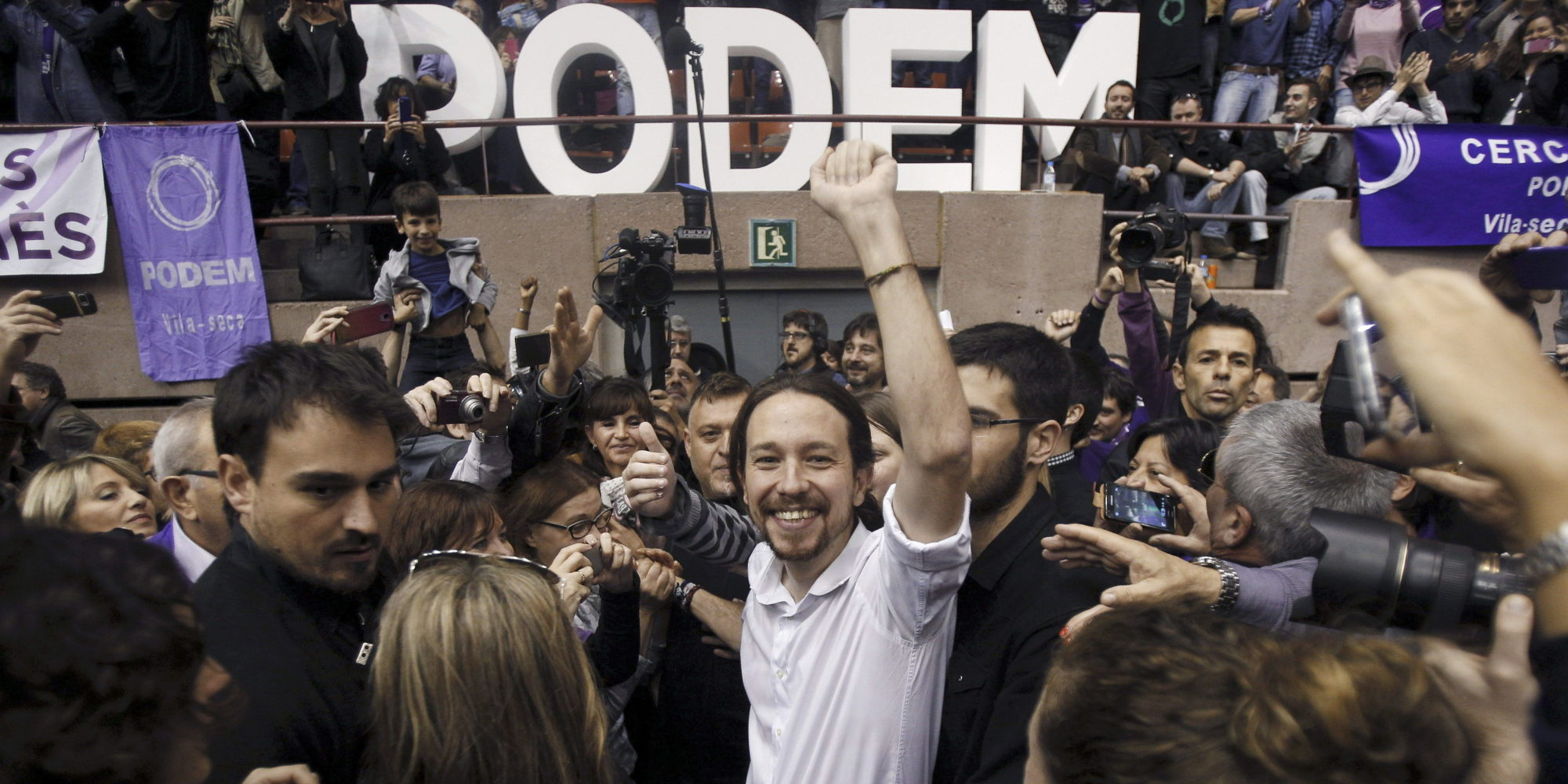General Secretary of Spanish party Podemos, Pablo Iglesias (C), attends a rally in Barcelona, Spain, 21 December 2014. Iglesias has reasserted his commitment with Catalonia's right to decide and has offered to open a constituent process to 'discuss with everyone about everything', but he also assured he will never embrace Prime Minister, Mariano Rajoy, or Catalonia's regional President, Artur Mas. EFE/Alejandro García