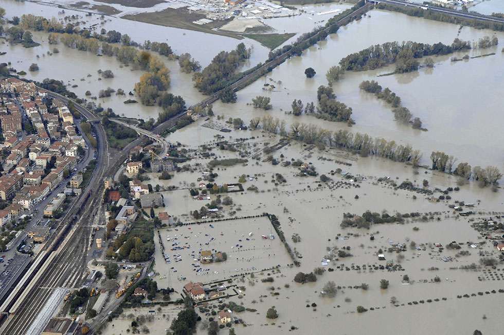 An aerial view of the area around the town of Orte, near Rome, where various homes, activities and infrastructures were damaged by flood water Tuesday, Nov. 13, 2012, as heavy rains battered north, central Italy and hard-hit Tuscany. Three people died after their car fell off a bridge that collapsed due to severe rainfalls, Tuesday near the town of Grosseto, Tuscany. (AP Photo/Giuseppe Palozzi)