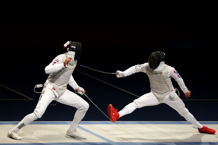 LONDON, ENGLAND - JULY 31:  Alaaeldin Abouelkassem of Egypt (L) competes against Byungchul Choi of Korea in the Men's Foil Individual Semifinal on Day 4 of the London 2012 Olympic Games at ExCeL on July 31, 2012 in London, England.  (Photo by Hannah Johnston/Getty Images)