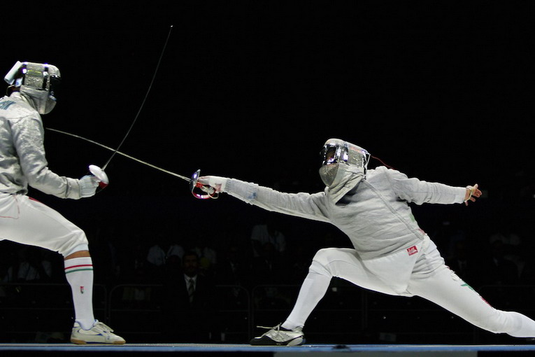 Athens, GREECE:  Italy's Aldo Montano (R) touches Hungary's Zsolt Nemcsik during the men's individual Sabre finale, at the Helliniko fencing hall in Athens, 14 August 2004, during the 2004 Olympic Games. Montano won the gold medal, Hungary's Zsolt Nemcsik took silver and Ukrain's Vladislav Tretiak received bronze. AFP PHOTO / THOMAS COEX  (Photo credit should read THOMAS COEX/AFP/Getty Images)
