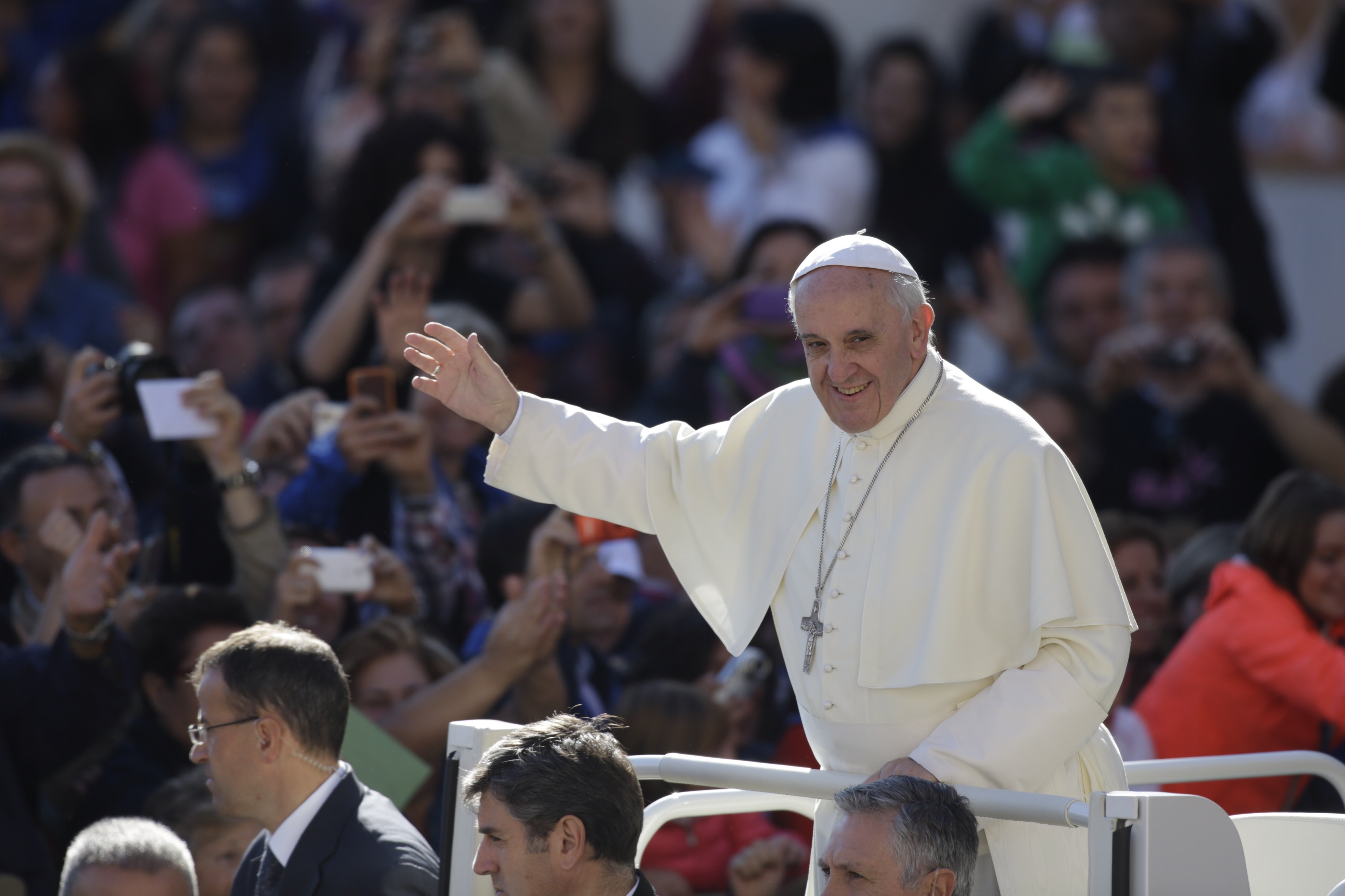 Pope Francis waves to faithful as he arrives for his weekly general audience at the Vatican, Wednesday, Oct. 2, 2013. (AP Photo/Andrew Medichini)