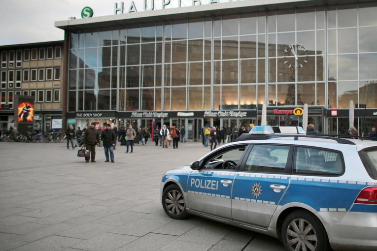 A police car passes the central railway station in Cologne, Germany Tuesday Jan. 5, 2016.  City officials and police in Cologne are holding a crisis meeting following a series of sex assaults in the western German city on New Year's Eve. Mayor Henriette Reker called Tuesday's meeting to discuss the police response to the assaults that occurred around Cologne's main train station, next to the city's famous cathedral, during the night. (Oliver Berg/dpa via AP)