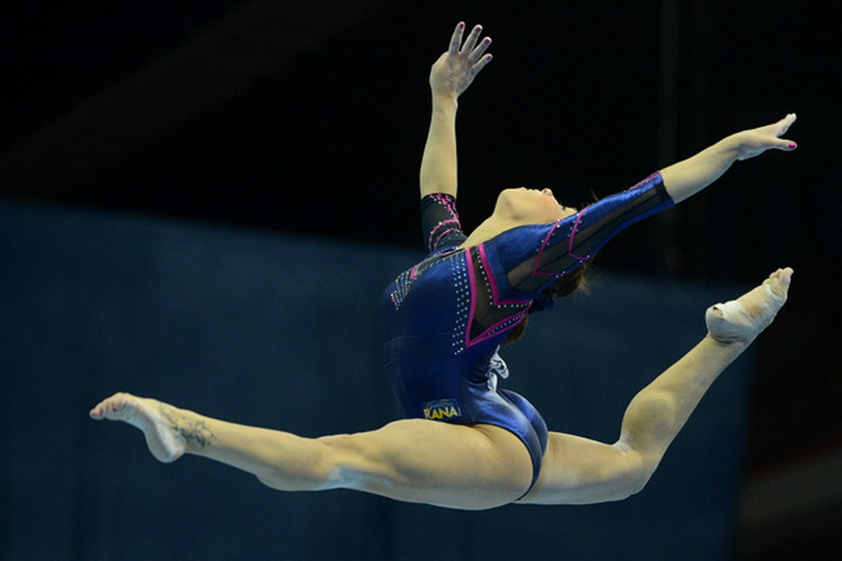 Italy's Vanessa Ferrari competes on the balance beam in the women's individual artistic gymnastics qualification during the 5th European Men's and Women's Artistic Gymnastic Individual Championships in Moscow on April 18, 2013. The 5th European Men's and Women's Artistic Gymnastic Individual Championships takes place in Moscow from April 17 to April 21. AFP PHOTO / NATALIA KOLESNIKOVA        (Photo credit should read NATALIA KOLESNIKOVA/AFP/Getty Images)
