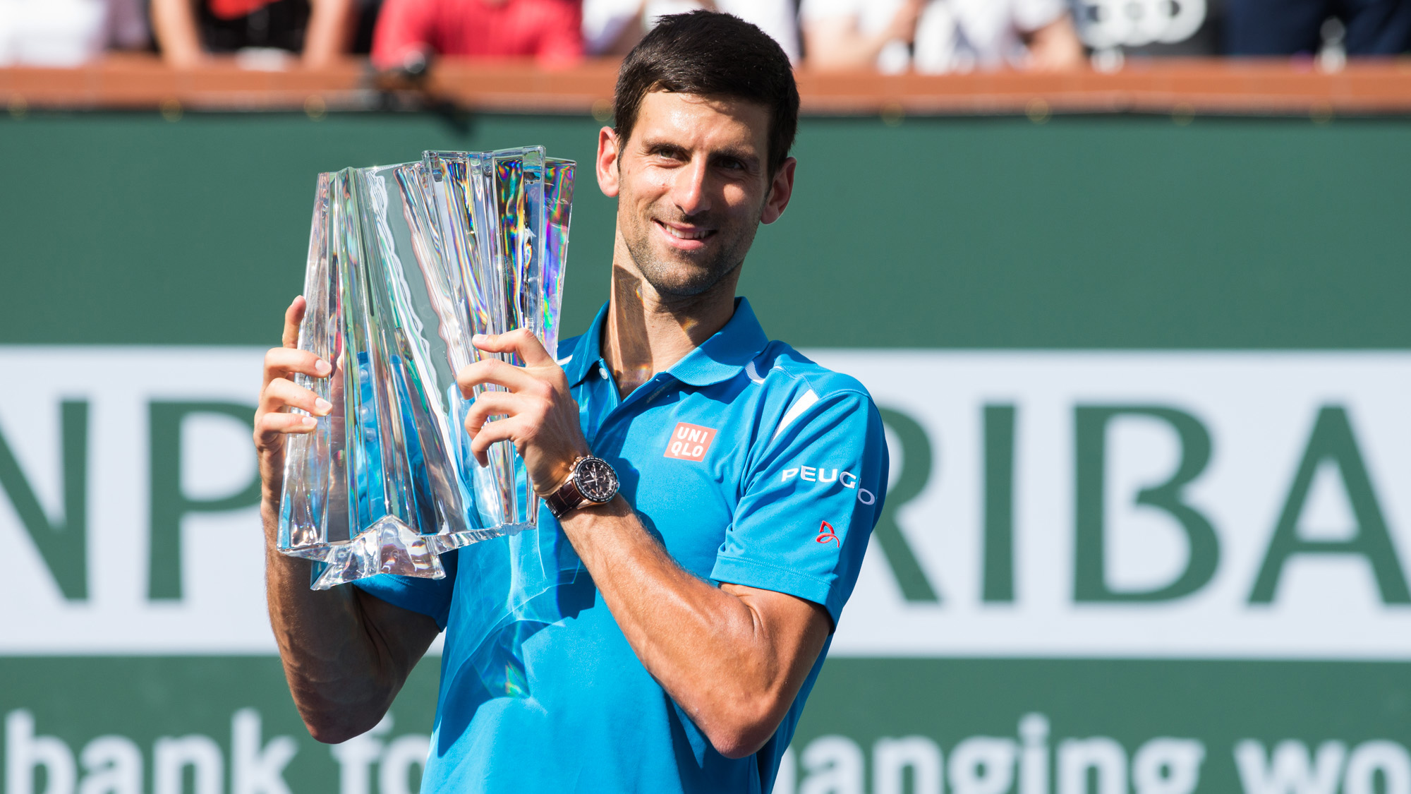 Novak Djokovic poses with his 2016 BNP Paribas Open trophy in Stadium 1 at the Indian Wells Tennis Garden in Indian Wells, California Sunday, March 20, 2016. (Photo by Jared Wickerham/BNP Paribas Open)