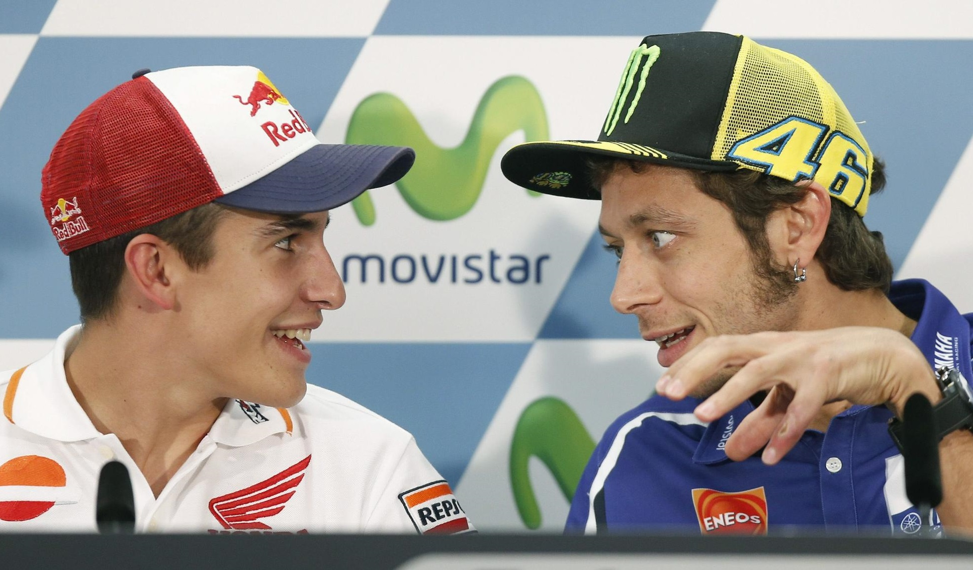 Italian MotoGP rider Valentino Rossi (R) of the Movistar Yamaha team talks with Spanish Marc Marquez (L) of the Repsol Honda team, during a press conference held at Motorland circuit, in Alcaniz, Teruel, northern Spain, 25 September 2014. The Motorcycling Grand Prix of Aragon will take place at the Motorland circuit on 28 September 2014. EFE/ANDREU DALMAU