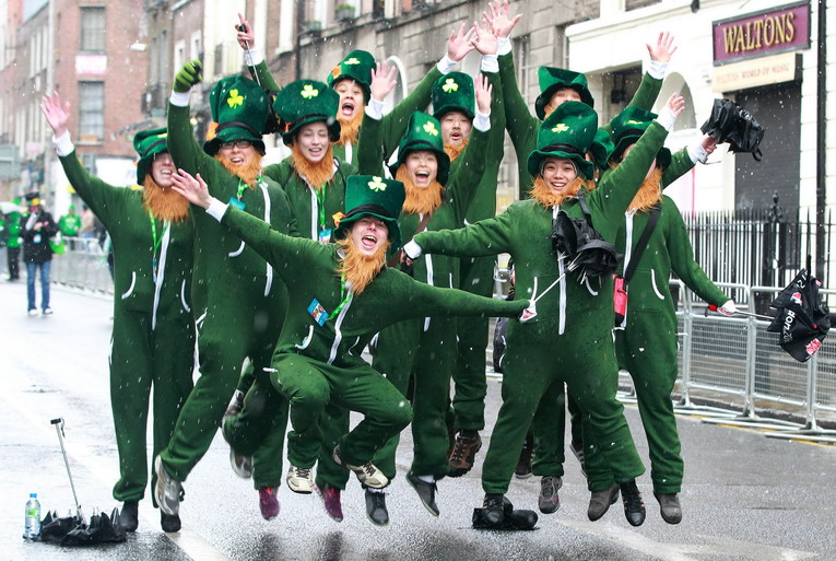 Parade goers dressed as leprechauns jumps up and shout as they prepare to attend St Patrick's Day festivities in Dublin on March 17, 2013. More than 100 parades are being held across Ireland to mark St Patrick's Day, the feast day of the patron saint of Ireland, with up to 650,000 spectators expected to attend the parade in Dublin. Ireland has high hopes that the festivities will bring a much-needed boost to the economy. AFP PHOTO/ PETER MUHLYPETER MUHLY/AFP/Getty Images