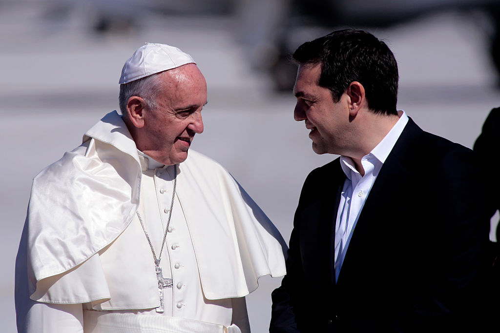 MYTILENE, GREECE - APRIL 16:  Pope Francis is greeted by Greek Prime Minister Alexis Tsipras as he arrives on the Greek island of Lesbos at Mytilene airport on April 16, 2016 in Myteline, Lesbos, Greece. Pope Francis will visit migrants at the Moria camp on the Greek island of Lesbos along with Greek Orthodox Ecumenical Patriarch Bartholomew I and Archbishop of Athens and All Greece, Ieronimos II.  (Photo by Milos Bicanski/Getty Images)