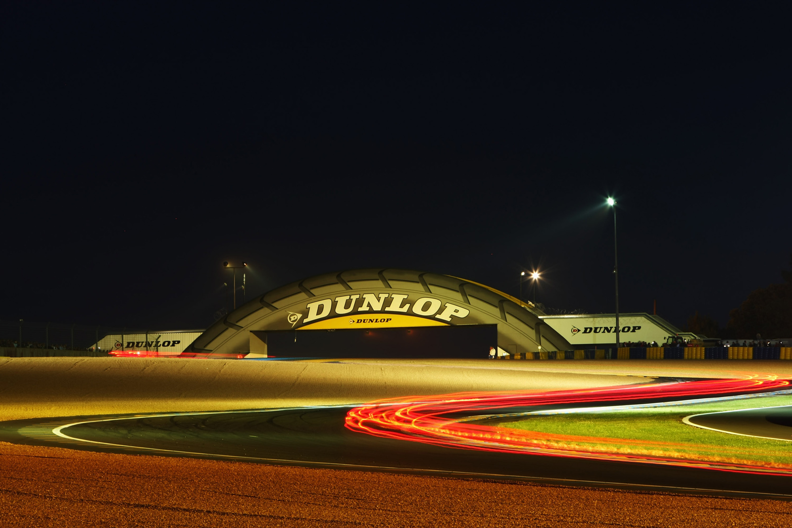 LE MANS, FRANCE - JUNE 14:  Cars go through the Dunlop Bridge Chicane during the 76th running of the Le Mans 24 Hour race at the Circuit des 24 Heures du Mans on June 14, 2008 in Le Mans, France.  (Photo by Mike Hewitt/Getty Images)