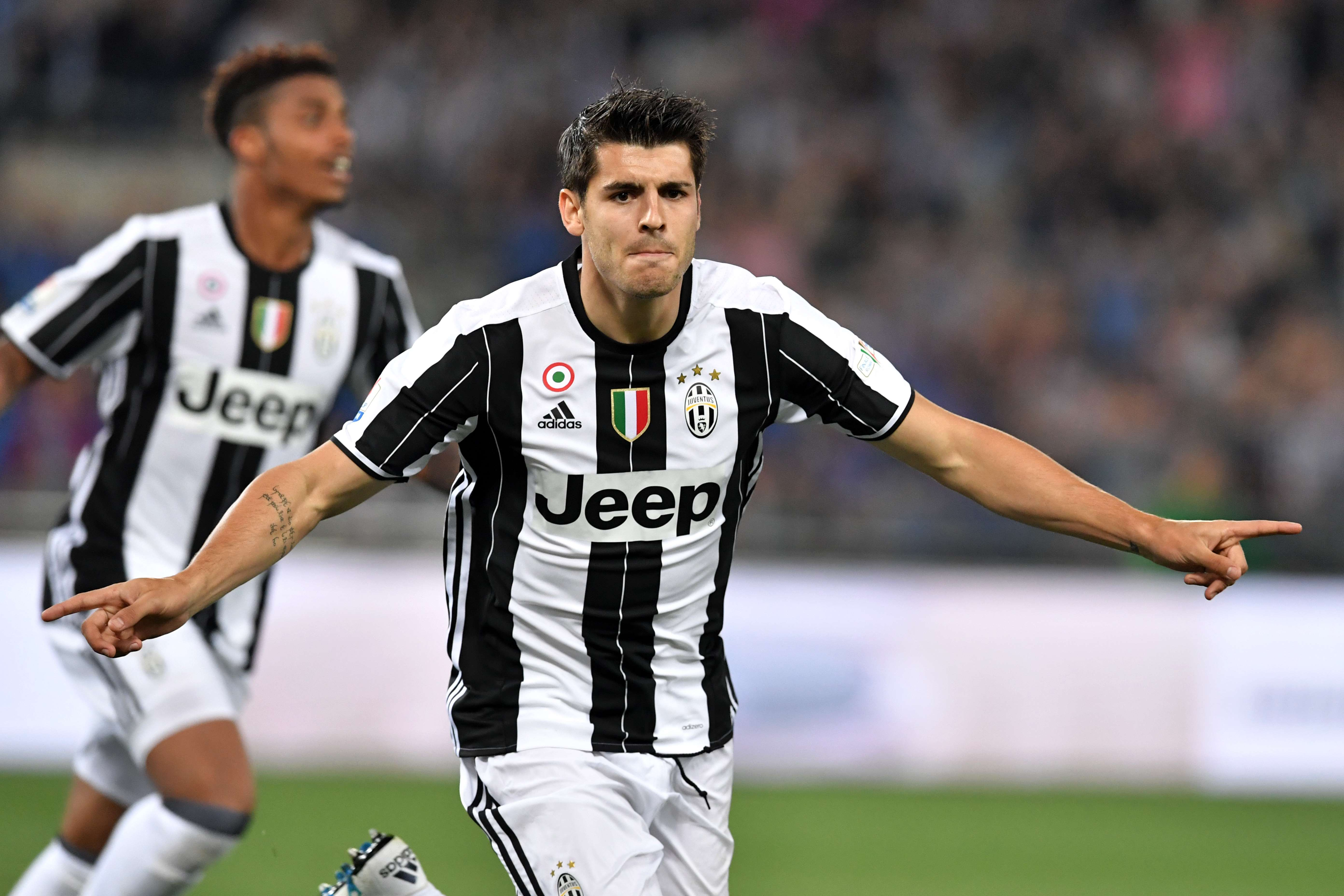 Juventus' forward from Spain Alvaro Morata celerates after scoring during the Italian Tim Cup final football match AC Milan vs Juventus on May 21, 2016 at the Olympic Stadium in Rome.     AFP PHOTO / TIZIANA FABI