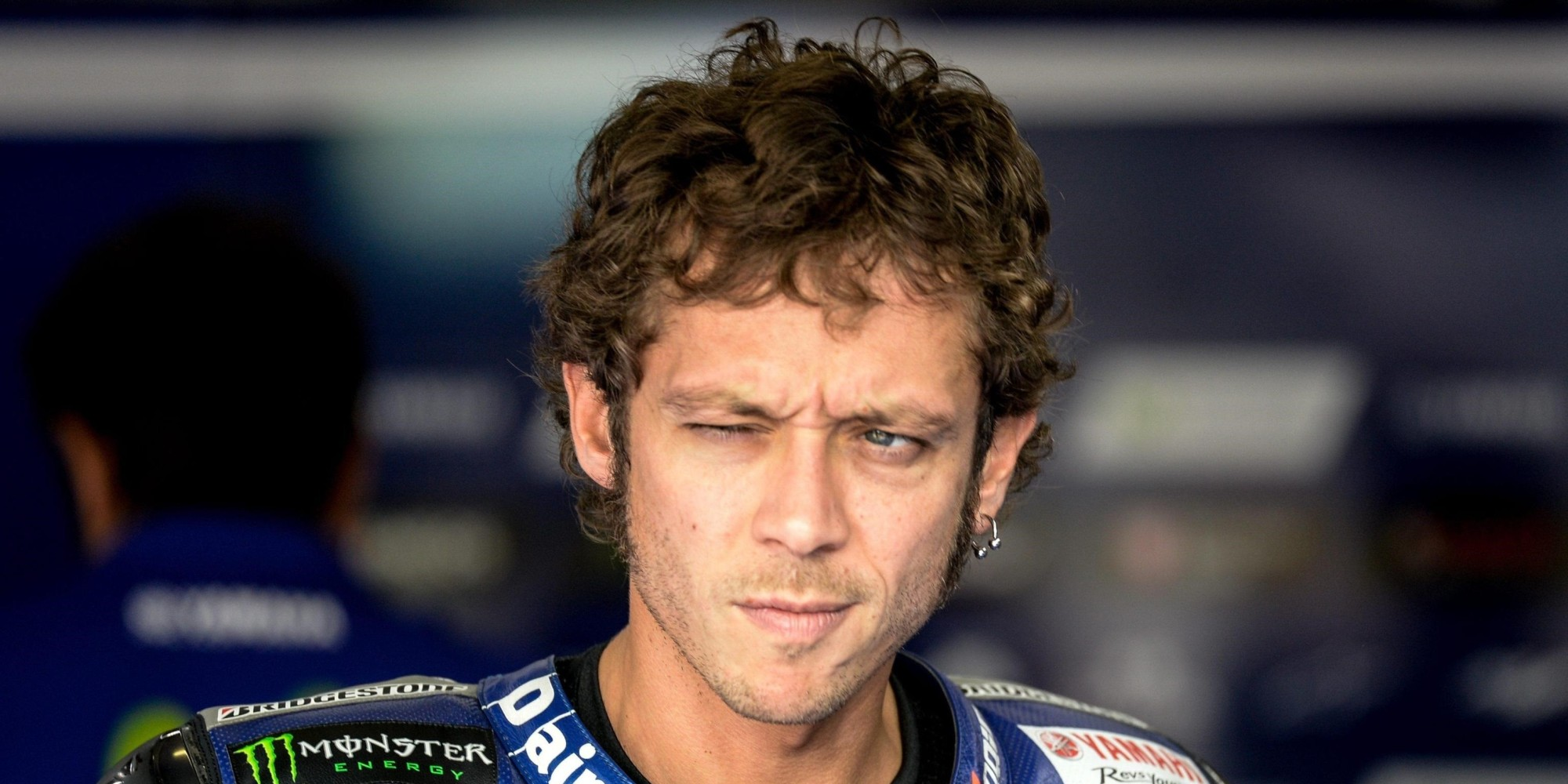 epaselect epa04883339 Yamaha MotoGP driver Valentino Rossi of Italy is seen in his team's box during the second free practice session of the Motorcycling Grand Prix of the Czech Republic at Masaryk circuit in Brno, Czech Republic, 14 August 2015. The Czech MotoGP race will take place on 16 August 2015.  EPA/FILIP SINGER