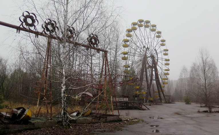 The swings and ferris wheel remain in an amusement park that was scheduled to open on May 1, 1986, for the Soviet May Day celebrations in Pirpyat, Ukraine. It never opened, as the Chernobyl disaster happened on April 26, 1986, a week before the opening.